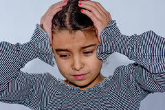 Little girl with headache isolated Stock Image
