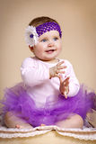 Little girl with headband in tutu skirt Stock Photos
