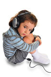 Little girl with headphone. Thoughtful little girl with headphone on white Royalty Free Stock Photo