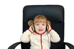 Little girl with headphones Royalty Free Stock Photo