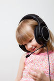 Little girl with headphones Stock Photos