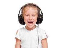 Little girl with headphones Royalty Free Stock Photos