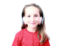 Little girl with headphones Royalty Free Stock Image