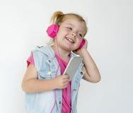 Little Girl Headphones Enjoy Music Concept Stock Images