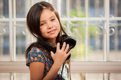 Little girl with headphones Royalty Free Stock Photography