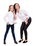 Little girl in headphones and her mother Stock Photography