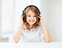 Little girl with headphones at home Royalty Free Stock Photos