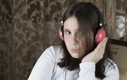 Little girl with headphones stock images