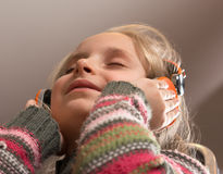 Little girl in headphones listening to music Royalty Free Stock Image