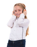 Little girl in headphones listening to music Royalty Free Stock Images
