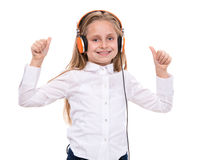 Little girl in headphones listening to music Royalty Free Stock Photography