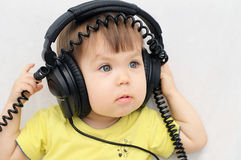 Little girl with headphones Royalty Free Stock Images