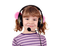 Little girl with headphones and microphone Stock Images