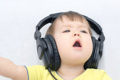 Little girl with headphones singing song Stock Image