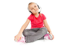 Little girl with headset Royalty Free Stock Photos
