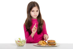 Little girl with healthy. Advice  little girl don't  eat  unhealthy food Royalty Free Stock Images
