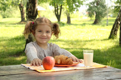 Little girl with healthy breakfast Stock Image