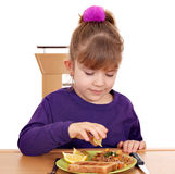 Little girl and healthy breakfast Stock Images