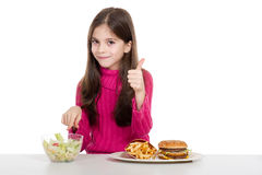 Little girl with healthy food. Little girl with thumb up advice  for  healthy  food Royalty Free Stock Photos