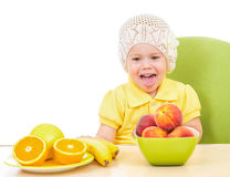Little girl with healthy food sitting at table Royalty Free Stock Images