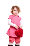 Little girl with heart. Little girl with curly blond hair holding heart Royalty Free Stock Photos