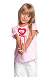 Little girl with heart. Portrait of little girl with heart isolated on white background Royalty Free Stock Image