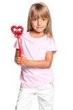 Little girl with heart. Portrait of little girl with heart isolated on white background Royalty Free Stock Images