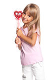 Little girl with heart. Beautiful little girl with heart isolated on white background Stock Photography