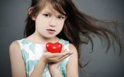 Little girl with a heart. Portrait of beautiful little girl with a heart Stock Photos