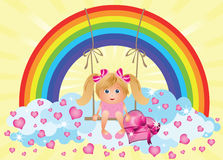 Little girl with heart and rainbow Royalty Free Stock Image