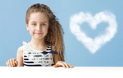 Little girl with a heart-shaped cloud royalty free stock photo