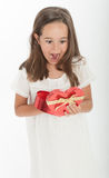 Little girl with heart shaped gift box. Little girl holding a heart shaped gift box Royalty Free Stock Photos