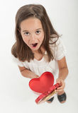 Little girl with heart shaped gift box. Little girl holding a heart shaped gift box Royalty Free Stock Photo