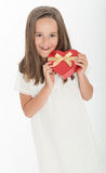 Little girl with heart shaped gift box. Little girl holding a heart shaped gift box Royalty Free Stock Photography