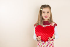 Little Girl with Heart-Shaped Pillow Royalty Free Stock Photography