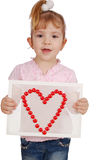 Little girl with heart symbol. Studio shot Royalty Free Stock Photography