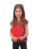Little girl with heart symbol. Portrait of little girl holding red heart symbol over white background Royalty Free Stock Photos