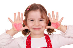 Little girl with hearts on hands Stock Image
