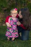 Little Girl Held by Big Sister Royalty Free Stock Photo
