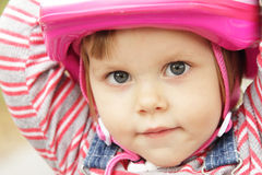Little girl with helmet Royalty Free Stock Photos