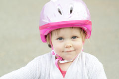 Little girl with helmet Royalty Free Stock Images