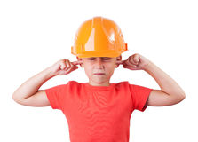 Little girl in a helmet. Tucked fingers in his ears Stock Images