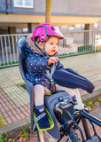 Little girl with helmet on head sitting in bike Royalty Free Stock Images