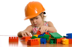 Little girl in a helmet plays Royalty Free Stock Photo