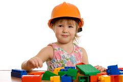 The little girl in a helmet plays Stock Photos