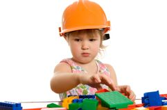 The little girl in a helmet plays Royalty Free Stock Photos