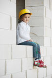 Little girl with helmet working on construction Royalty Free Stock Images