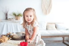 Relationship in the family with small children. Little girl help cooking, concept of love and family well-being. Little girl help cooking, concept of love and royalty free stock image