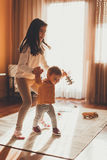 Little girl helping baby sister to walk Stock Image