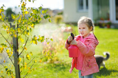 Little girl helping in a garden Stock Images